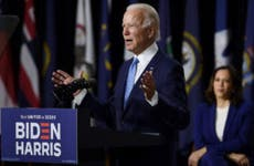 Former Vice President Joe Biden speaks at a press conference in Wilmington, Delaware, beside vice presidential running mate, U.S. Senator Kamala Harris.
