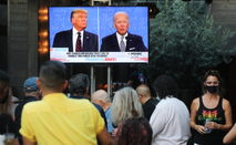 People sit and watch a broadcast of the first debate between President Donald Trump and Democratic presidential nominee Joe Biden.