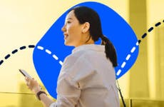 An Asian woman looks hapy against a blue and yellow background
