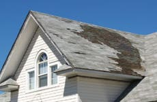 A close-up of a roof in desperate need of repair.