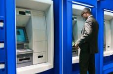 Man using ATM.