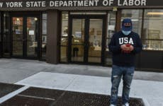 A man stands outside the New York State Department of Labor.