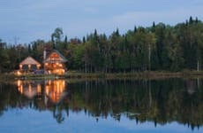 Lake home viewed at dusk across the water.