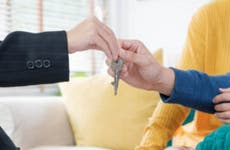 Close up of hands as couple gets keys to a new house.