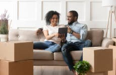 Couple looks at a tablet in a new home